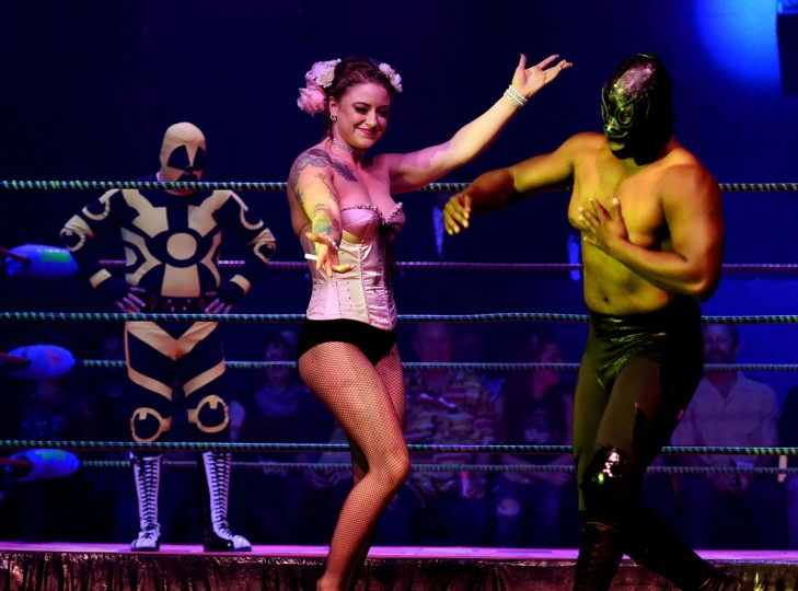 "Wrestlers Bomba Atomico (left) and Monsanta (right) wait for their opponents during the Lucha Va Voom's ""Crazy in Love"" show at the Mayan Theatre in downtown Los Angeles, California on February 10, 2016. (MARK RALSTON/AFP/Getty Images)"