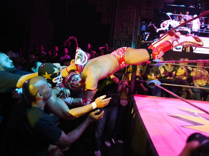 """Wrestlers Matt Classic (left) is hit by a opponent Cacao (right) during the Lucha Va Voom's """"Crazy in Love"""" show at the Mayan Theatre in downtown Los Angeles, California on February 10, 2016. (MARK RALSTON/AFP/Getty Images)"""
