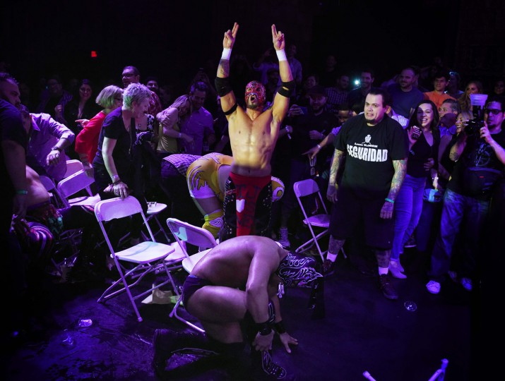 """Wrestler Rey Horus celebrates over his opponent during the Lucha Va Voom's """"Crazy in Love"""" show at the Mayan Theatre in downtown Los Angeles, California on February 10, 2016. (MARK RALSTON/AFP/Getty Images)"""
