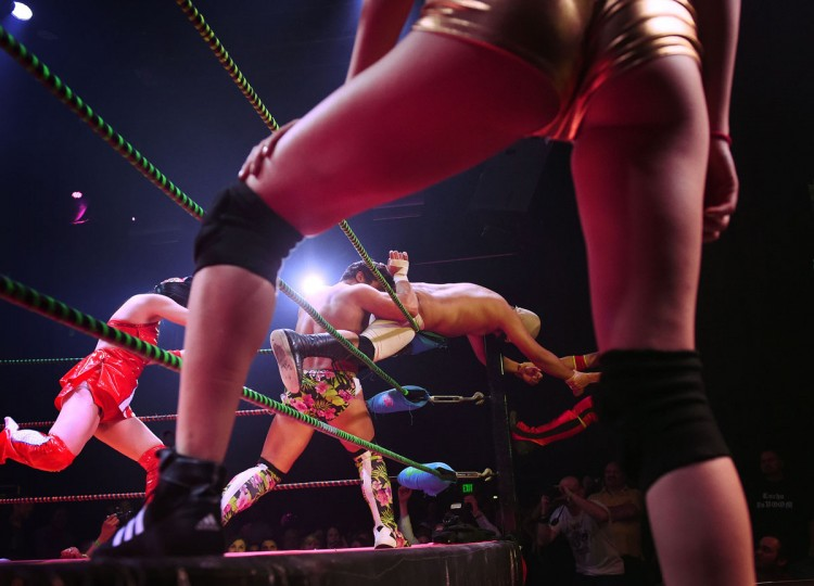 "Wrestlers Joey Ryan (center left) and opponent Dirty Sanchez (center right) fight during the Lucha Va Voom's ""Crazy in Love"" show at the Mayan Theatre in downtown Los Angeles, California on February 10, 2016. (MARK RALSTON/AFP/Getty Images)"