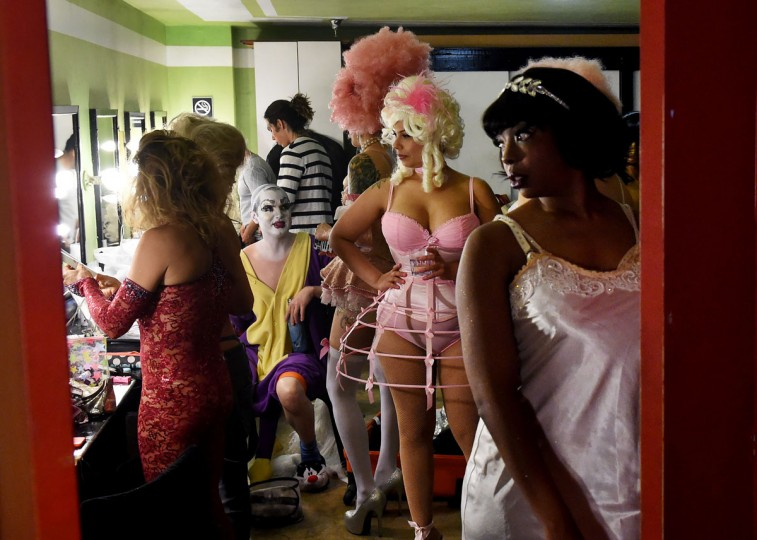 """Performers prepare makeup backstage before the Lucha Va Voom's """"Crazy in Love"""" show at the Mayan Theatre in downtown Los Angeles, California on February 10, 2016. (MARK RALSTON/AFP/Getty Images)"""