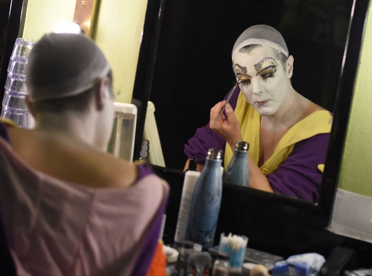 "Performers prepare makeup backstage before the Lucha Va Voom's ""Crazy in Love"" show at the Mayan Theatre in downtown Los Angeles, California on February 10, 2016. (MARK RALSTON/AFP/Getty Images)"