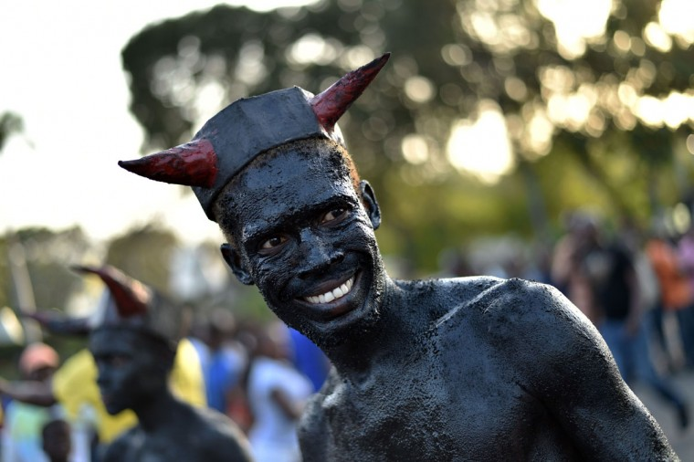 A reveler with body painted in motor oil depicting the devil performs during of 2016 National Carnival Parade on February 9, 2016, in Port-au-Prince, Haiti. (HECTOR RETAMAL/AFP/Getty Images)