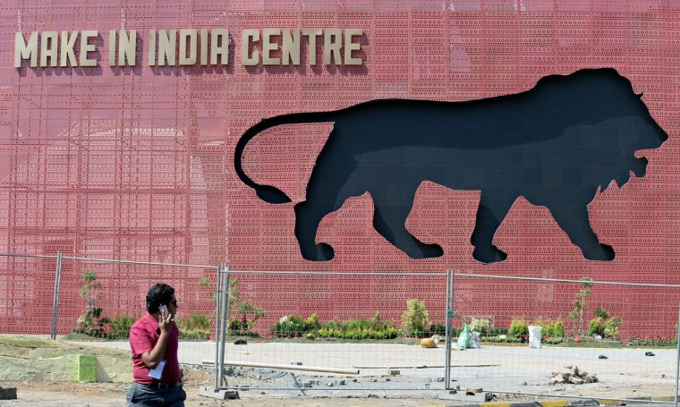 A participant walks through the venue for the 'Make in India' showcase week in Mumbai on February 11, 2016. (INDRANIL MUKHERJEE/AFP/Getty Images)
