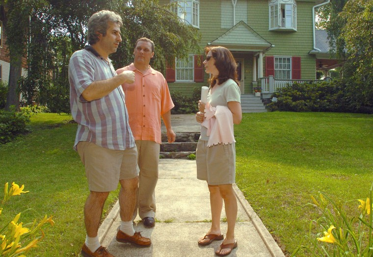 Realtor Scott Smith of Keller Williams Realty (center) shows a Roland Park home to Ahmet Baschat and his wife, Miriam Doyle-Baschat. (Doug Kapustin/For The Baltimore Sun)
