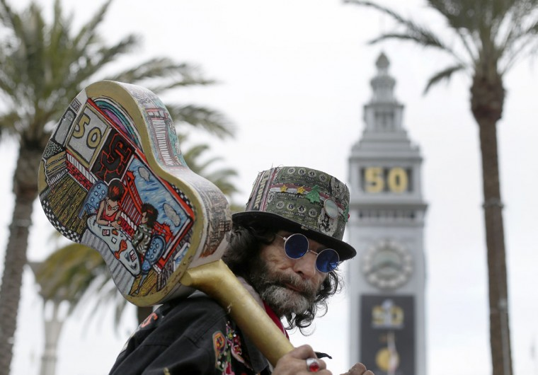 Eddie Sanchez looks at attractions at Super Bowl City Wednesday, Feb. 3, 2016, in San Francisco. (AP Photo/Charlie Riedel)
