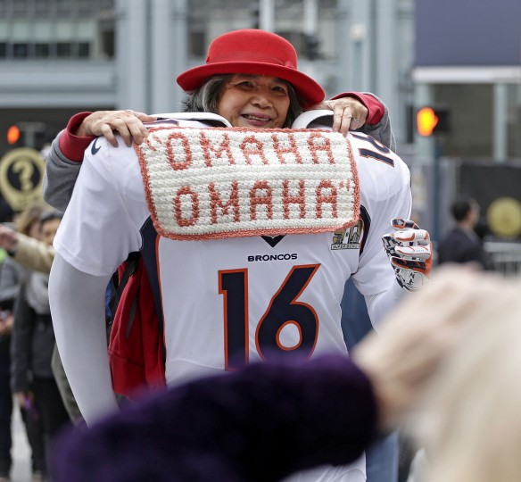 Perla Bautista poses for a photo on a cutout of a Denver Broncos football player at Super Bowl City Wednesday, Feb. 3, 2016, in San Francisco. (AP Photo/Charlie Riedel)