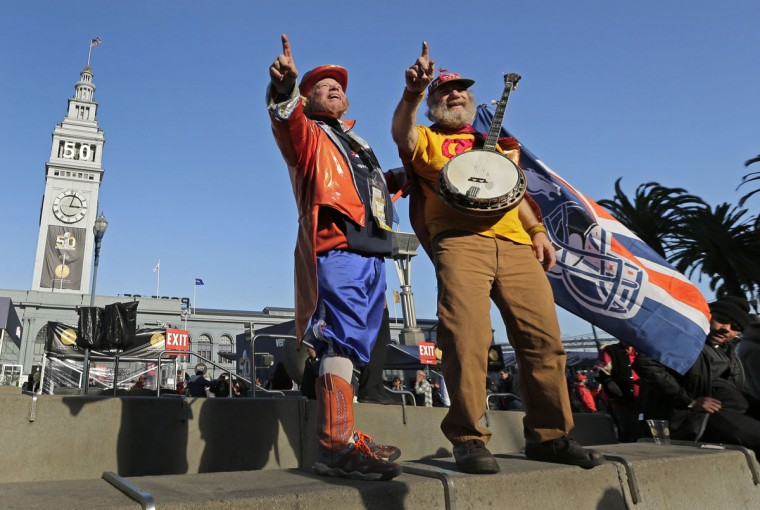 Denver Broncos fan Rocky Brougham, left, and San Francisco 49ers fan Stacy Samuels pose for photos at Super Bowl City Tuesday, Feb. 2, 2016 in San Francisco. Both men have dressed in costume and lead the crowd in cheers at their respective stadiums for 33 years. The Denver Broncos play the Carolina Panthers in the NFL Super Bowl 50 football game Sunday, Feb. 7, 2015, in Santa Clara, Calif. (AP Photo/Charlie Riedel)