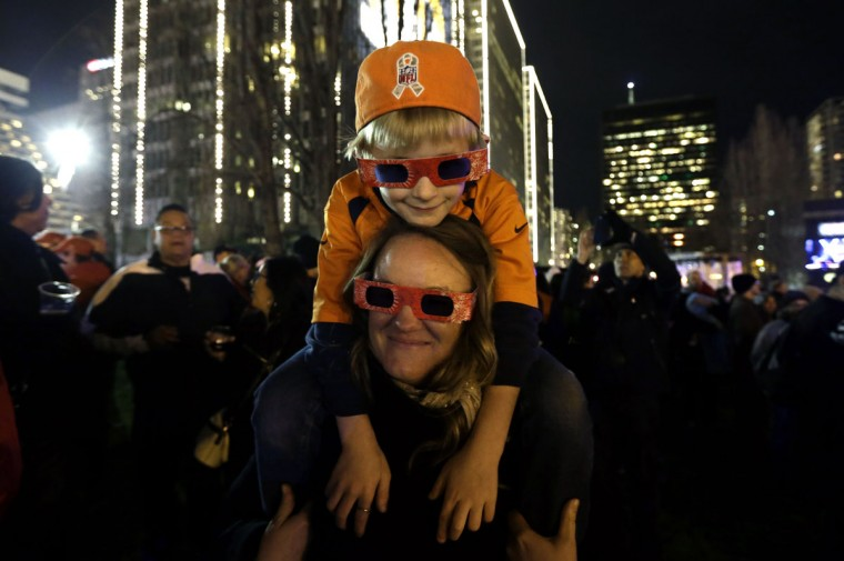 Fans wait for fireworks at Super Bowl City Saturday, Jan. 30, 2016, in San Francisco. The Denver Broncos will play the Carolina Panthers in Super Bowl 50 Sunday, Feb. 7, 2016. (AP Photo/David J. Phillip)