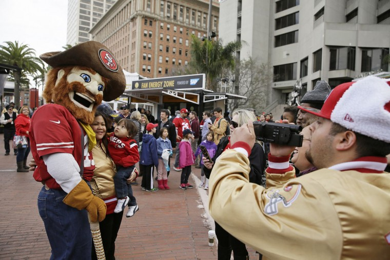 Sourdough Sam, the San Francisco 49ers mascot, poses with fans at Super Bowl City, a pro-football's weeklong theme park near the famed Ferry Building on The Embarcadero in San Francisco on Wednesday, Feb. 3, 2016. Super Bowl City is a free-to-the-public fan village to celebrate Super Bowl 50. (AP Photo/Eric Risberg)