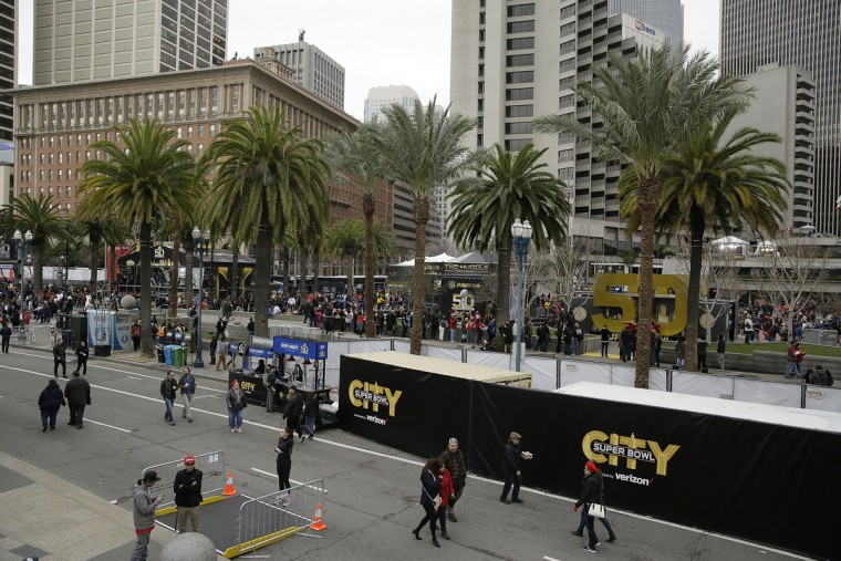 People walk through Super Bowl City Wednesday, Feb. 3, 2016, in San Francisco. Super Bowl City is a free-to-the-public fan village to celebrate Super Bowl 50. (AP Photo/Eric Risberg)