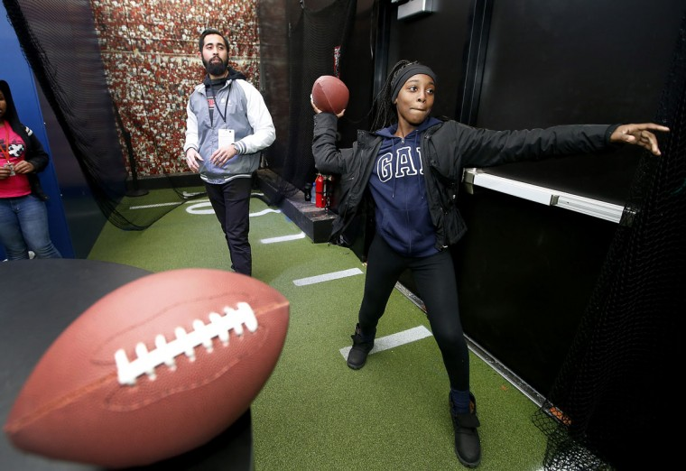 A student from Lavonya DeJean Middle School in Richmond, Calif., throws a football in the pass analysis activity in the Chevron STEM Zone in Super Bowl City on Tuesday, Feb. 2, 2016 in San Francisco. The Chevron STEM Zone is an interactive exhibit that brings the science behind football to life for fans in Super Bowl City. (Tony Avelar/AP Images for Chevron)