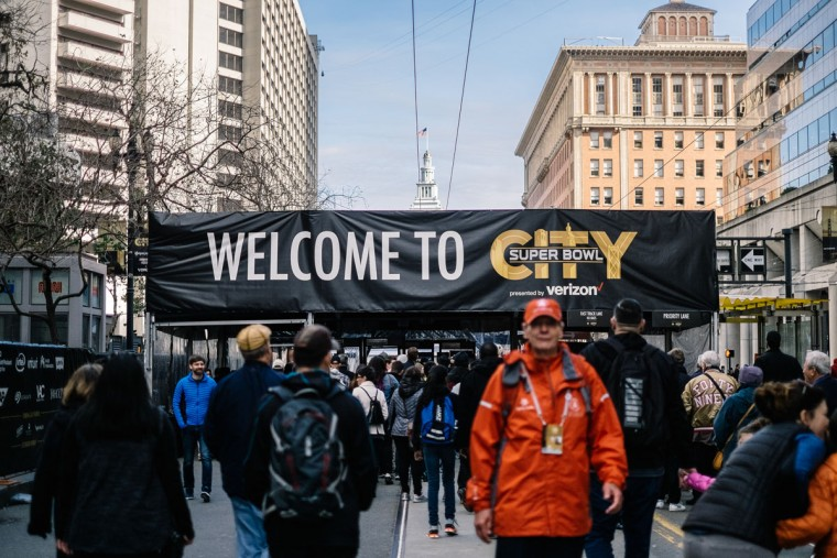 Super Bowl 50 fans are seen entering Super Bowl City on February 3, 2016 in San Francisco, California. (Photo by Mike Windle/Getty Images)