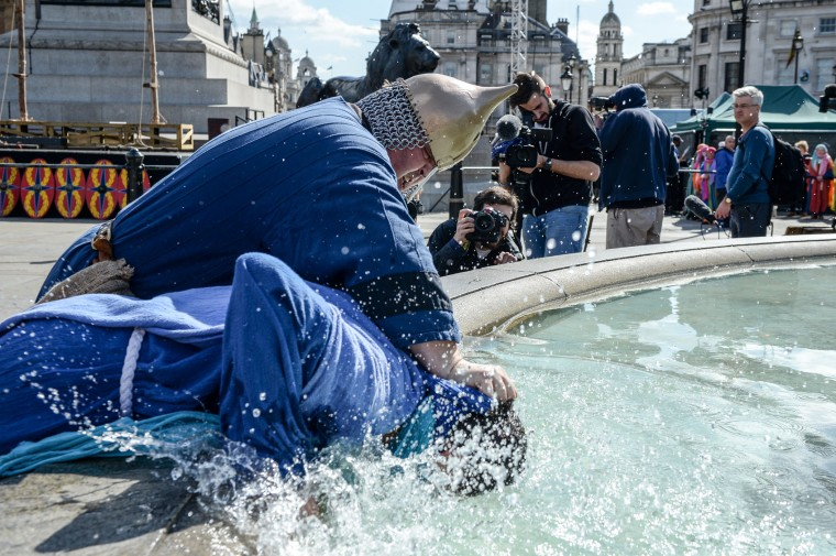 One of Jesus' disciples is dunked in a fountain during The Wintershall's 'The Passion of Jesus' in front of crowds on Good Friday at Trafalgar Square on March 25, 2016 in London, England. The Wintershall's theatrical production of 'The Passion of Jesus' includes a cast of 100 actors, horses, a donkey and authentic costumes of Roman soldiers in the 12th Legion of the Roman Army. Good Friday is a Christian religious holiday before Easter Sunday, which commemorates the crucifixion of Jesus Christ on the cross. (Photo by Chris Ratcliffe/Getty Images)