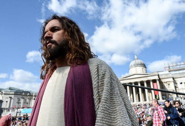 Actor James Burke-Dunsmore plays Jesus during The Wintershall's 'The Passion of Jesus' in front of crowds on Good Friday at Trafalgar Square on March 25, 2016 in London, England. The Wintershall's theatrical production of 'The Passion of Jesus' includes a cast of 100 actors, horses, a donkey and authentic costumes of Roman soldiers in the 12th Legion of the Roman Army. Good Friday is a Christian religious holiday before Easter Sunday, which commemorates the crucifixion of Jesus Christ on the cross. (Photo by Chris Ratcliffe/Getty Images)