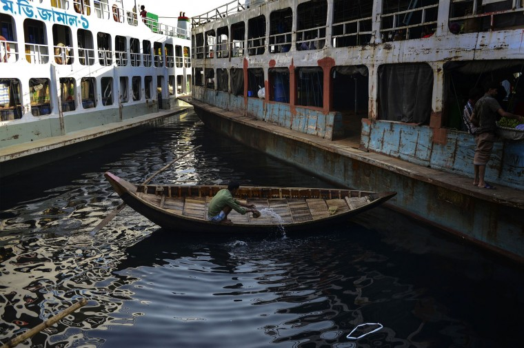 A Bangladeshi boatman washes his boat with polluted water from the Burignaga river in Dhaka on March 22, 2016. International World Water Day is held annually on March 22 to focus global attention on the importance of water and advocating for the sustainable management of our water resources. (Munir Uz Zaman/AFP/Getty Images)