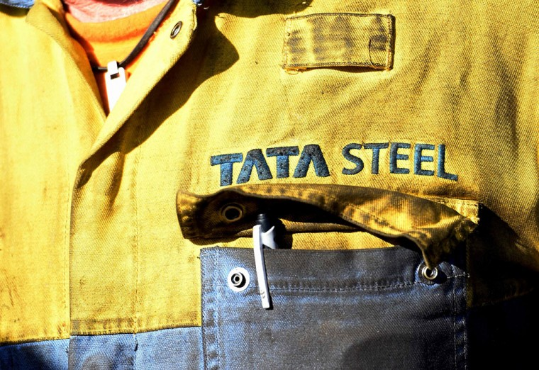 A Tata Steel worker waits for British opposition Labour Party leader Jeremy Corbyn at the Tata sports and social club close to the company's works at Port Talbot, south Wales, on March 30, 2016. Indian giant Tata Steel on March 30, 2016 put its British business up for sale, sparking calls for the government to intervene and safeguard thousands of jobs in the crisis-hit industry. Corbyn called on the government to protect the UK steel industry after earlier writing to the prime minister to call on him to recall parliament from the Easter break. (AFP Photo/Paul Ellis)