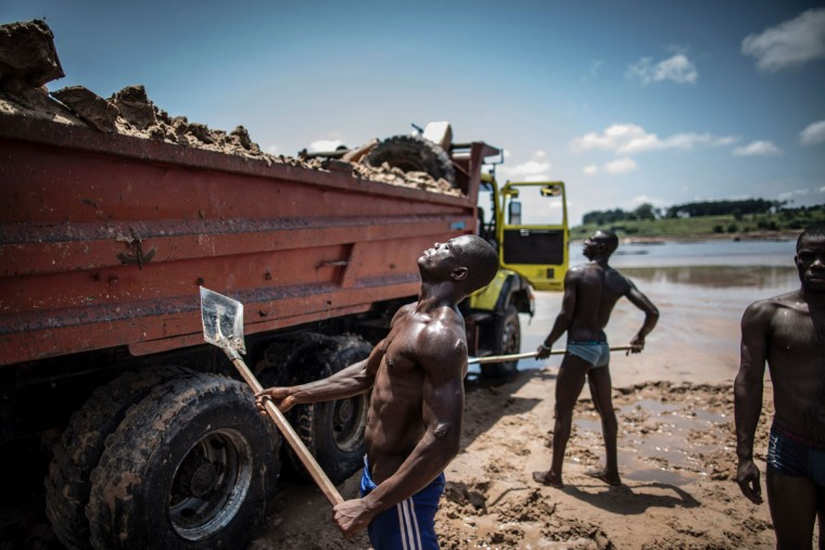 Sand diggers are seen loading trucks at a quarry on the banks of the Congo river in the Kombe district of Brazzaville on March 28, 2016. (MARCO LONGARI/AFP/Getty Images)