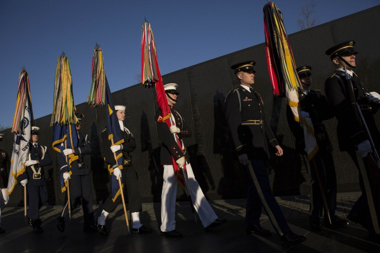 A Joint Services Honor Guard arrives prior to a wreath laying ceremony to commemorate the 50th anniversary of the Vietnam War at the Vietnam Veterans Memorial March 29, 2016 in Washington, DC. In 2012, President Barack Obama signed a presidential proclamation declaring March 29 Vietnam Veterans Day. (Photo by Drew Angerer/Getty Images)