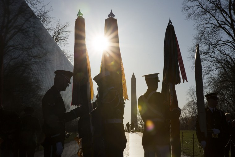 Members of a Joint Services Honor Guard prepare prior to a wreath laying ceremony to commemorate the 50th anniversary of the Vietnam War at the Vietnam Veterans Memorial March 29, 2016 in Washington, DC. In 2012, President Barack Obama signed a presidential proclamation declaring March 29 Vietnam Veterans Day. (Photo by Drew Angerer/Getty Images)
