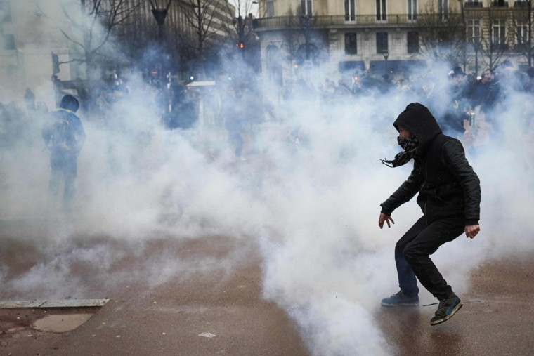 A protester clashes with police during a demonstration on March 9, 2016, in Lyon, central-eastern France, as part of a nationwide day of protest against proposed labour reforms. France faced a wave of protests on March 9 against deeply unpopular labour reforms that have divided an already-fractured Socialist government and raised hackles in a country accustomed to iron-clad job security. (AFP / Jean-Philippe Ksiazek)