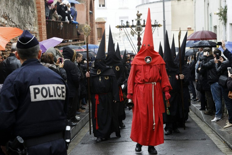 People watch penitents parading during the Sanch procession that celebrates its 600's birthday on March 25, 2016 in Perpignan. As every Good Friday since 1416, the religious procession of la Sanch traverse takes place in the streets of the French city Perpignan to do penance and perpetrate a Catalan cultural tradition that exist for six centuries. Christian believers around the world mark the Holy Week of Easter in celebration of the crucifixion and resurrection of Jesus Christ. (Raymond Roig/AFP/Getty Images)