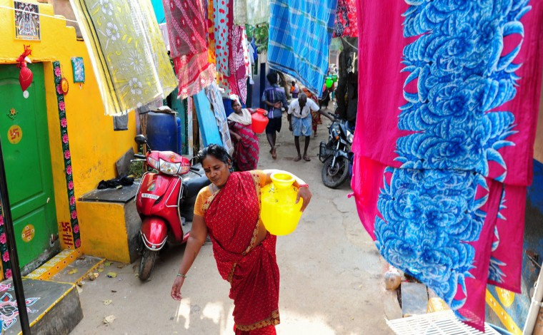 An Indian woman carries a pot containing drinking water at a residential area in Chennai on March 22, 2016. International World Water Day is marked annually on March 22 to focus global attention on the importance of water and advocate for sustainable water resource management. (Arun Sankar/AFP/Getty Images)