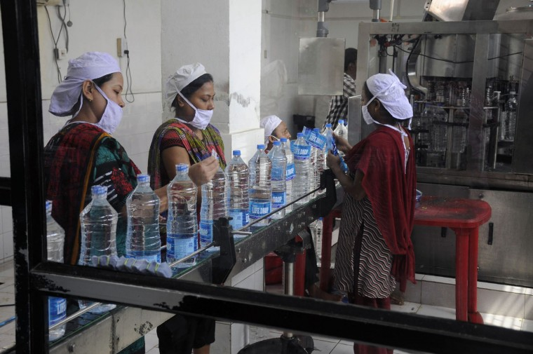 Indian workers add labels onto bottles of drinking water at a bottling unit on World Water Day in Agartala, capital of norhteastern state of Tripura, on March 22, 2016. (Arindam Dey/AFP/Getty Images)