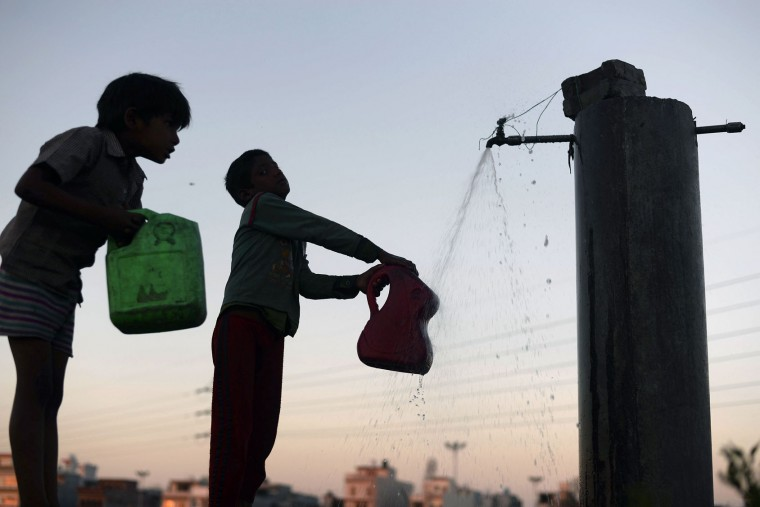 Indian children fill containers with water from a tap on World Water Day in Jalandhar on March 22, 2016. International World Water Day is marked annually on March 22 to focus global attention on the importance of water and advocate for sustainable water resource management. (Shammi Mehra/AFP/Getty Images)