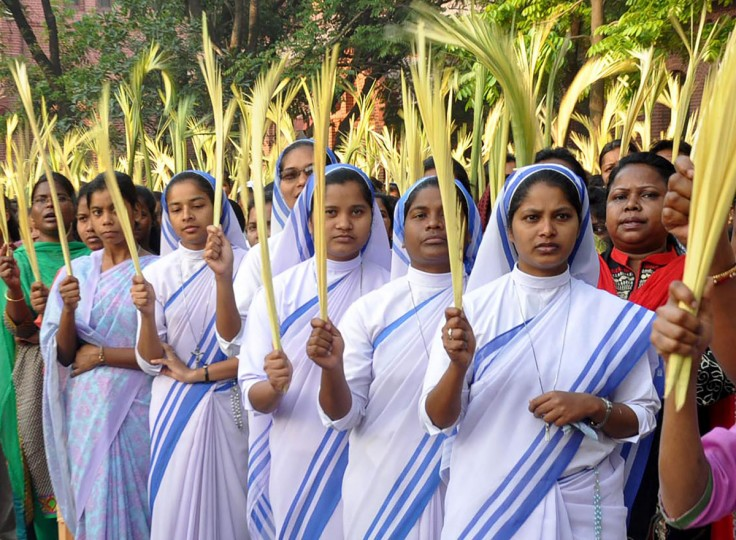 Indian Christian Nuns wave palm fronds as they take part in a procession to commemerate Palm Sunday in Ranchi on March 20, 2016. Palm Sunday is a movable feast in the Christian calendar which falls on the Sunday before Easter. The feast commemorates the entry of Jesus into Jerusalem prior to his crucifixion. Palm Sunday marks the beginning of Holy Week which commemorates events in the last days of Jesus Christ's life on earth. (AFP PHOTO / STRSTR)