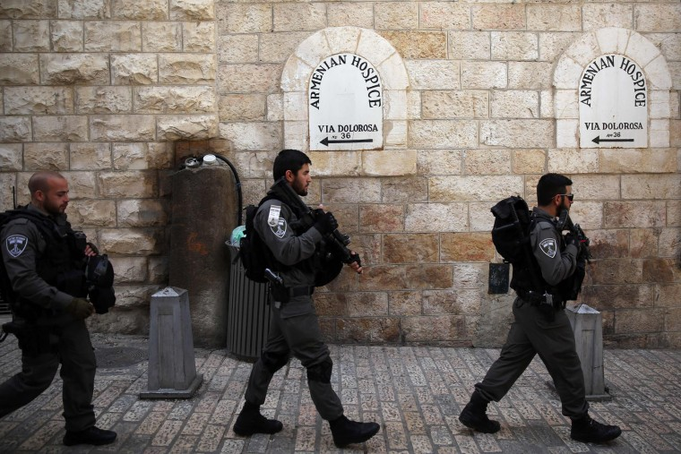 Israeli border policemen deployed at the Via Dolorosa (Way of Suffering) in Jerusalems Old City a head of the Good Friday procession on March 25, 2016. Many Christian pilgrims took part in processions along the route where according to tradition Jesus Christ carried the cross during his last days. (Gali Tibbon/AFP/Getty Images)