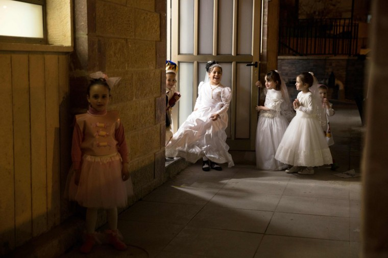 Ultra-Orthodox Jewish children play before reading the book of Esther at a synagogue in the Israeli city of Beit Shemesh on March 23, 2016 during the feast of Purim. The carnival-like Purim holiday is celebrated with parades and costume parties to commemorate the deliverance of the Jewish people from a plot to exterminate them in the ancient Persian empire 2,500 years ago, as recorded in the Biblical Book of Esther. (AFP Photo/Menahem Kahana)