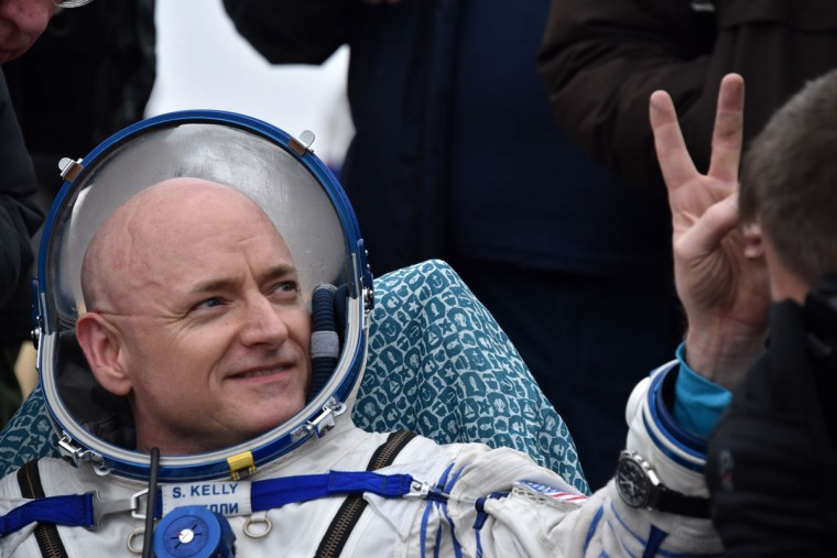 International Space Station (ISS) crew member Scott Kelly of the U.S. shows a victory sign after landing near the town of Dzhezkazgan, Kazakhstan, on March 2, 2016. Kelly and Russian cosmonaut Mikhail Kornienko returned to Earth on March 2 after spending almost a year in space in a ground-breaking experiment foreshadowing a potential manned mission to Mars. (KIRILL KUDRYAVTSEV/AFP/Getty Images)