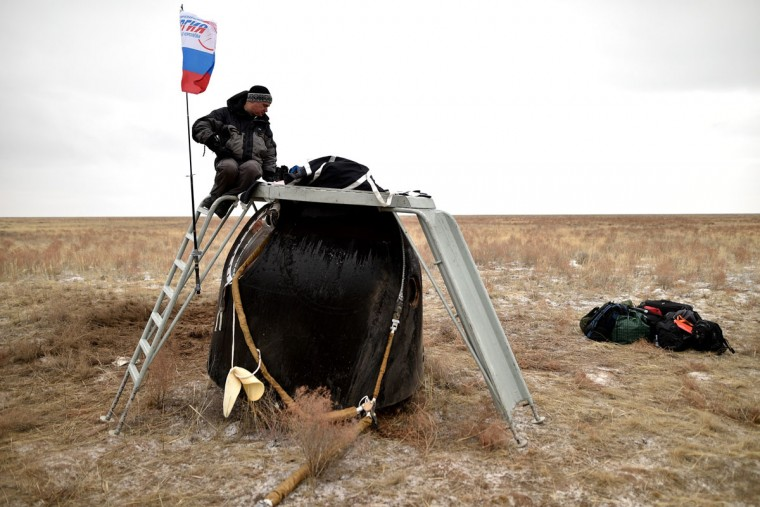 A search and rescue team works at the site of landing of the Soyuz TMA-18M space capsule carrying the International Space Station (ISS) crew of US astronaut Scott Kelly and Russian cosmonauts Mikhail Kornienko and Sergei Volkov near the town of Dzhezkazgan, Kazakhstan, on March 2, 2016. (KIRILL KUDRYAVTSEV/AFP/Getty Images)