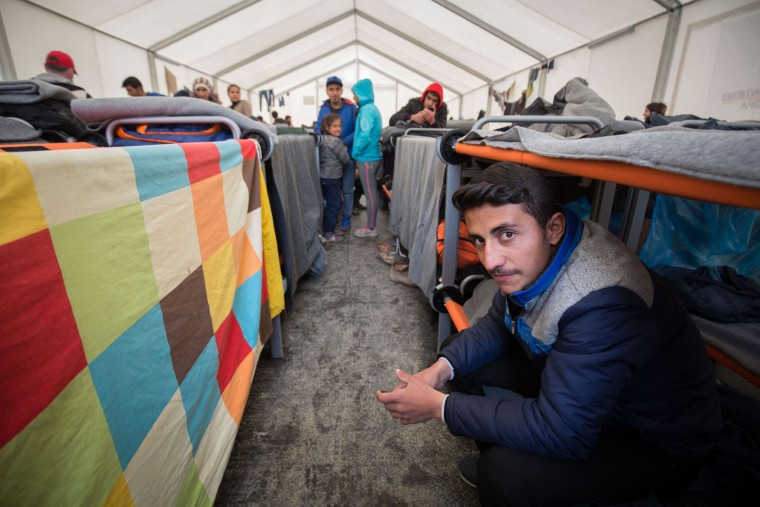 A man sits on his bunk bed inside a accommodation tent at the Idomeni refugee camp on the Greek Macedonia border on March 16, 2016 in Idomeni, Greece. The decision by Macedonia to close its border to migrants last week has left thousands of people stranded at the Greek transit camp. The closure, following the lead taken by neighbouring countries, has effectively sealed the so-called western Balkan route, the main migration route that has been used by hundreds of thousands of migrants to reach countries in western Europe such as Germany. Humanitarian workers have described the conditions at the camp as desperate, which has been made much worse by recent spells of heavy rain. (Photo by Matt Cardy/Getty Images)