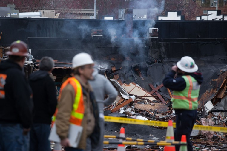 A natural gas explosion destroyed businesses on Greenwood Avenue during the early morning hours on March 9, 2015 in Seattle, Washington. Nine firefighters who were battling the blaze were injured, but have since been released from Harborview Medical Center according to Seattle Fire Department. (Matt Mills McKnight/Getty Images)