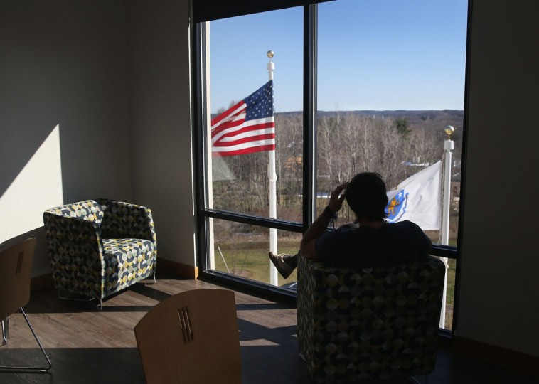 WESTBOROUGH, MA - MARCH 22: A drug addict in recovery looks out from a substance abuse treatment center on March 22, 2016 in Westborough, MA. The new 100-bed residential rehab center, run by Spectrum Health Systems, is expanding staff, as communities across New England are struggling with the unprecidented heroin and opioid pain pill epidemic. On March 15, the U.S. Centers for Disease Control (CDC), announced guidelines for doctors to reduce the amount of opioid painkillers prescribed nationwide, in an effort to curb the epidemic. The CDC estimates that most new heroin addicts first became hooked on prescription pain medication before graduating to heroin, which is stronger and cheaper. (John Moore/Getty Images)