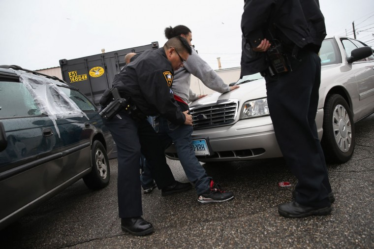 NEW LONDON, CT - MARCH 14: New London police officers search a suspect for heroin on March 14, 2016 in New London, CT. Police say an increasing number of suburban addicts are coming into the city to buy heroin, which is much cheaper than opioid painkillers. On March 15, the U.S. Centers for Disease Control (CDC), announced guidelines for doctors to reduce the amount of opioid painkillers prescribed nationwide. The CDC estimates that most new heroin addicts first became hooked on prescription pain medication before graduating to heroin, which is stronger and cheaper. (John Moore/Getty Images)