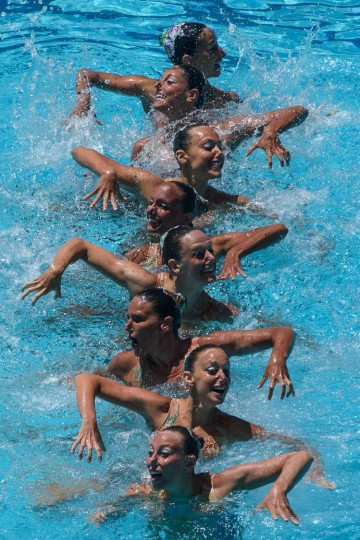 The synchronized swimming team of Italy performs during the teams' free routine final of the FINA Synchronized Swimming Olympic Games Qualification Tournament at the Maria Lenk Aquatic Centre in Rio de Janeiro, Brazil, on March 6, 2016. (Yasuyoshi Chiba/AFP/Getty Images)