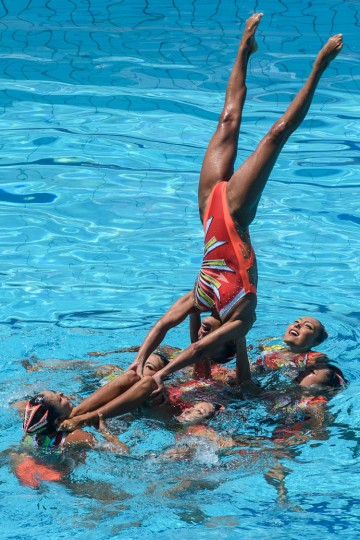 The synchronized swimming team of Japan performs during the teams' free routine final of the FINA Synchronized Swimming Olympic Games Qualification Tournament at the Maria Lenk Aquatic Centre in Rio de Janeiro, Brazil, on March 6, 2016. (Yasuyoshi Chiba/AFP/Getty Images)