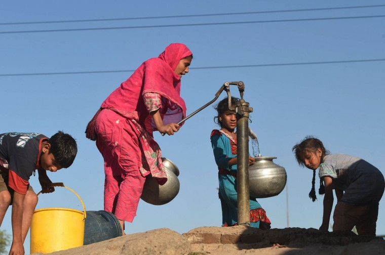 Pakistani girls fill water pots from a hand pump at a slum area of Lahore on March 21, 2016, on the eve of World Water Day. International World Water Day is held annually on March 22 to focus global attention on the importance of water and advocating for the sustainable management of our water resources. (Arif Ali/AFP/Getty Images)