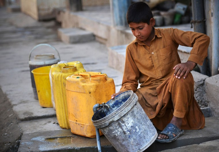 A Pakistani child fills a bucket with water in a makeshift settlement in Peshawar on March 22, 2016. International World Water Day is held annually on March 22 to focus global attention on the importance of water and advocate for sustainable water resource management. (A Majeed/AFP/Getty Images)