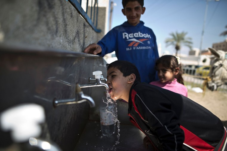 A Palestinian boy drinks from a tap delivering drinking water for free on March 22, 2016 in the town of Beit Lahia, in the northern Gaza Strip. International World Water Day is marked annually on March 22 to focus global attention on the importance of water and advocate for sustainable water resource management. (Mahmud Hams/AFP/Getty Images)