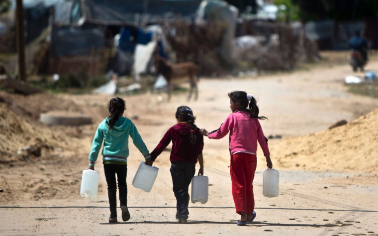 Palestinian girls carry empty containers on March 22, 2016 in the town of Beit Lahia, in the northern Gaza Strip. International World Water Day is marked annually on March 22 to focus global attention on the importance of water and advocate for sustainable water resource management.(Mahmud Hams/AFP/Getty Images)