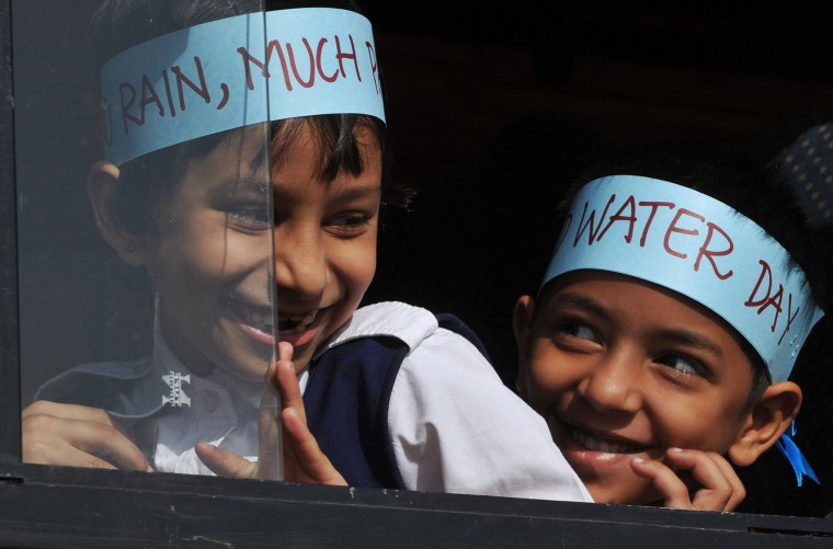 Indian school children take part in an awareness rally held to mark World Water Day in Hyderabad on March 22, 2016. The United Nations World Water Day is marked annually on March 22 and in 2016 focuses on the positive impact water quantity and quality can have on workers lives and livelihoods, and societies and economies. (Noah Seelam/AFP/Getty Images)