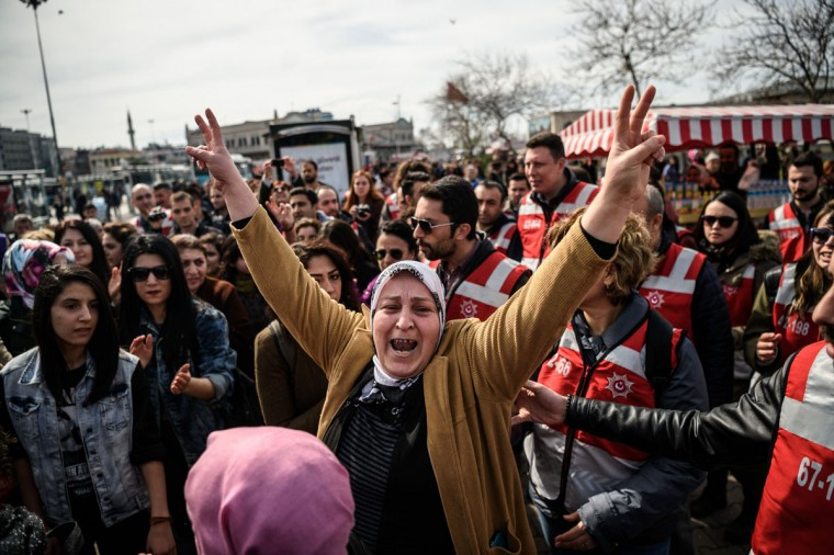 A Turkish woman gives a V sign during a march in the Kadikoy district of Istanbul to mark International Women's Day on March 6, 2016. (Ozan Kose/AFP/Getty Images)