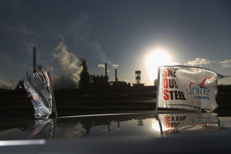 'Save Our Steel' flags fly from a car outside the Tata Steel plant on March 30, 2016 in Port Talbot, Wales. Indian owners Tata Steel put its British business up for sale yesterday, placing thousands of jobs at risk and hitting the already floundering UK steel industry. (Photo by Christopher Furlong/Getty Images)