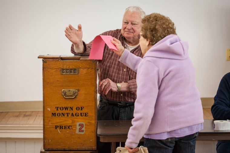Poll worker John Mayrand mans a manual, crank operated, ballot box on March 01, 2016 in Montague, MA. Officials are expecting a record turnout of voters in Massachusetts, one of a dozen states holding Super Tuesday presidential primaries or caucuses. (Photo by Matthew Cavanaugh/Getty Images)