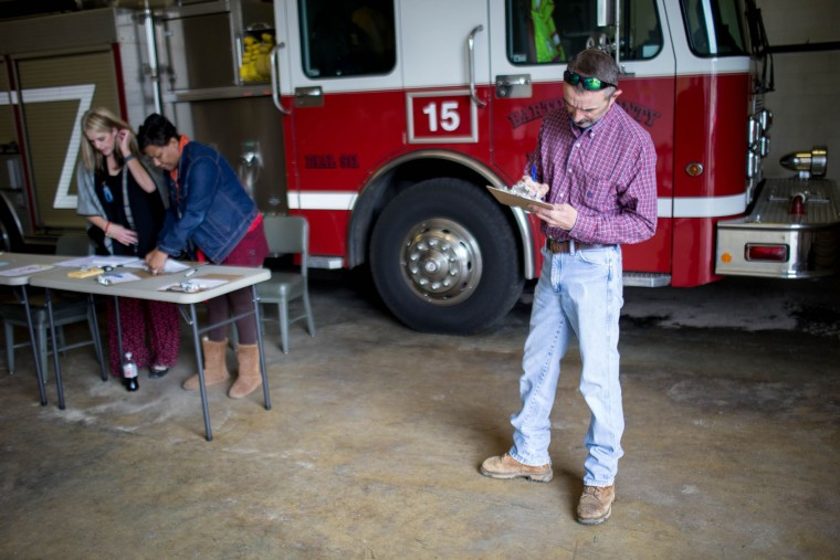 Brian Adcock fills out voting paper work before casting his ballot at a fire station on Super Tuesday March 1, 2016, in Adairsville, Georgia. Voters head to the polls to cast their votes on Georgia's presidential primary. (Photo by Branden Camp/Getty Images)