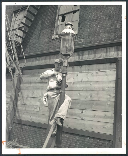 Gas lamps on August 4, 1957. The lamp at Fawn and Stemmers Alley was the last to be removed in Baltimore. (Bodine).